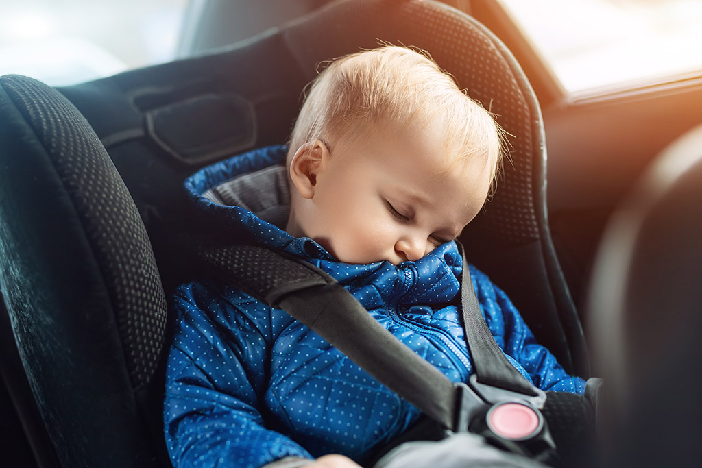 Baby asleep in a car seat