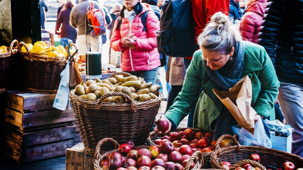 People buying from a local food market