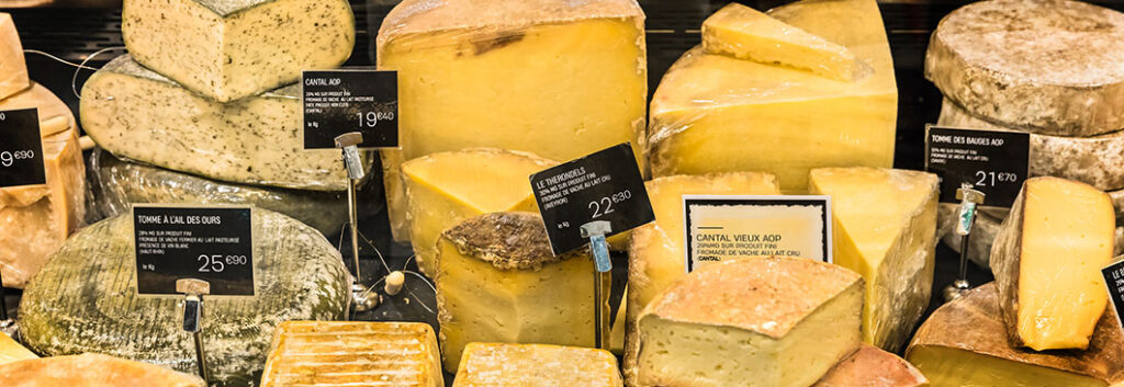 A selection of cheeses at a cheese counter