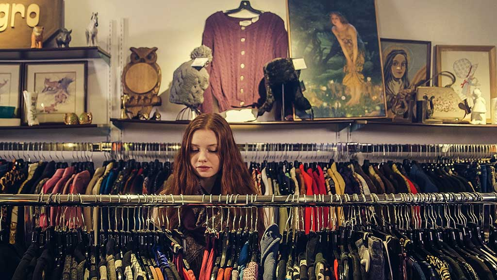 Girl looking through a thrift store