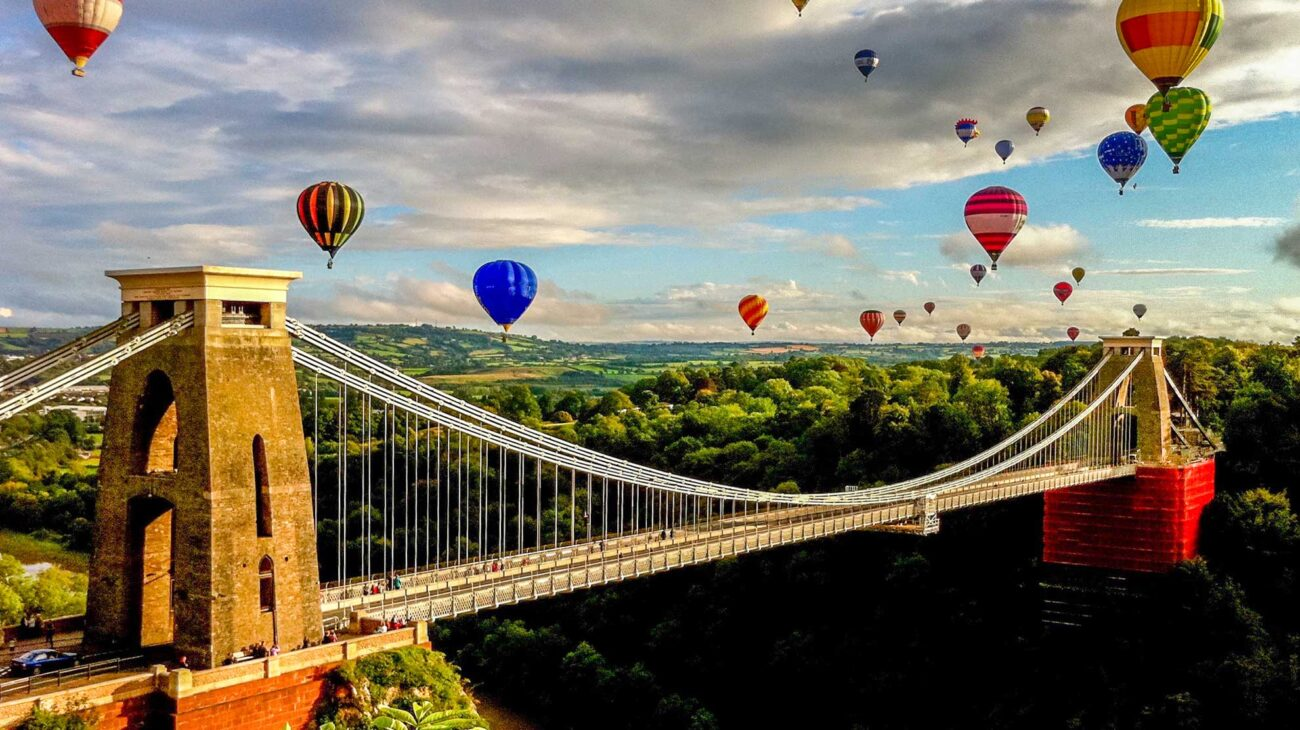 Clifton suspension bridge in Bristol with hot air balloons
