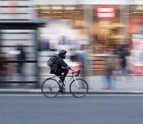 Person cycling on London street