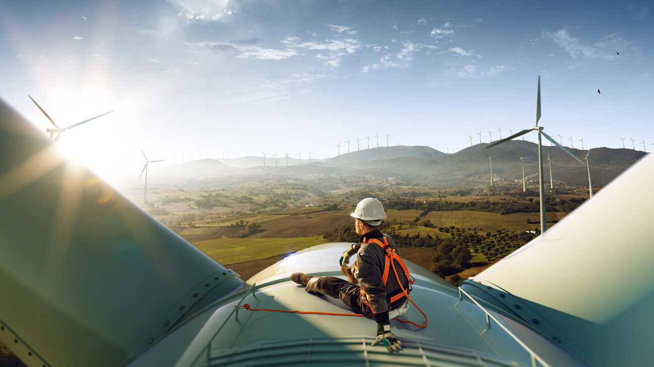 Engineer on top of a wind turbine