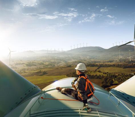 Engineer on top of a wind turbine
