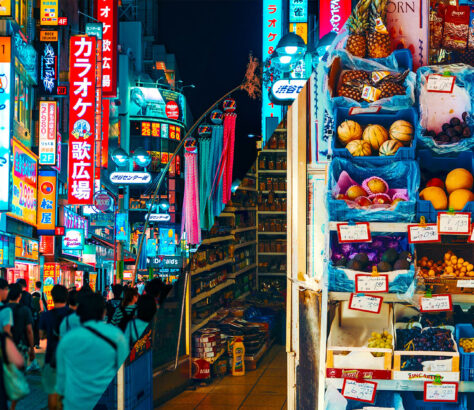 Bright light city versus local grocery shop