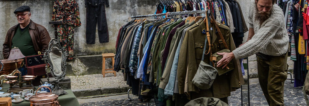 Second hand market stall of clothes and antiques