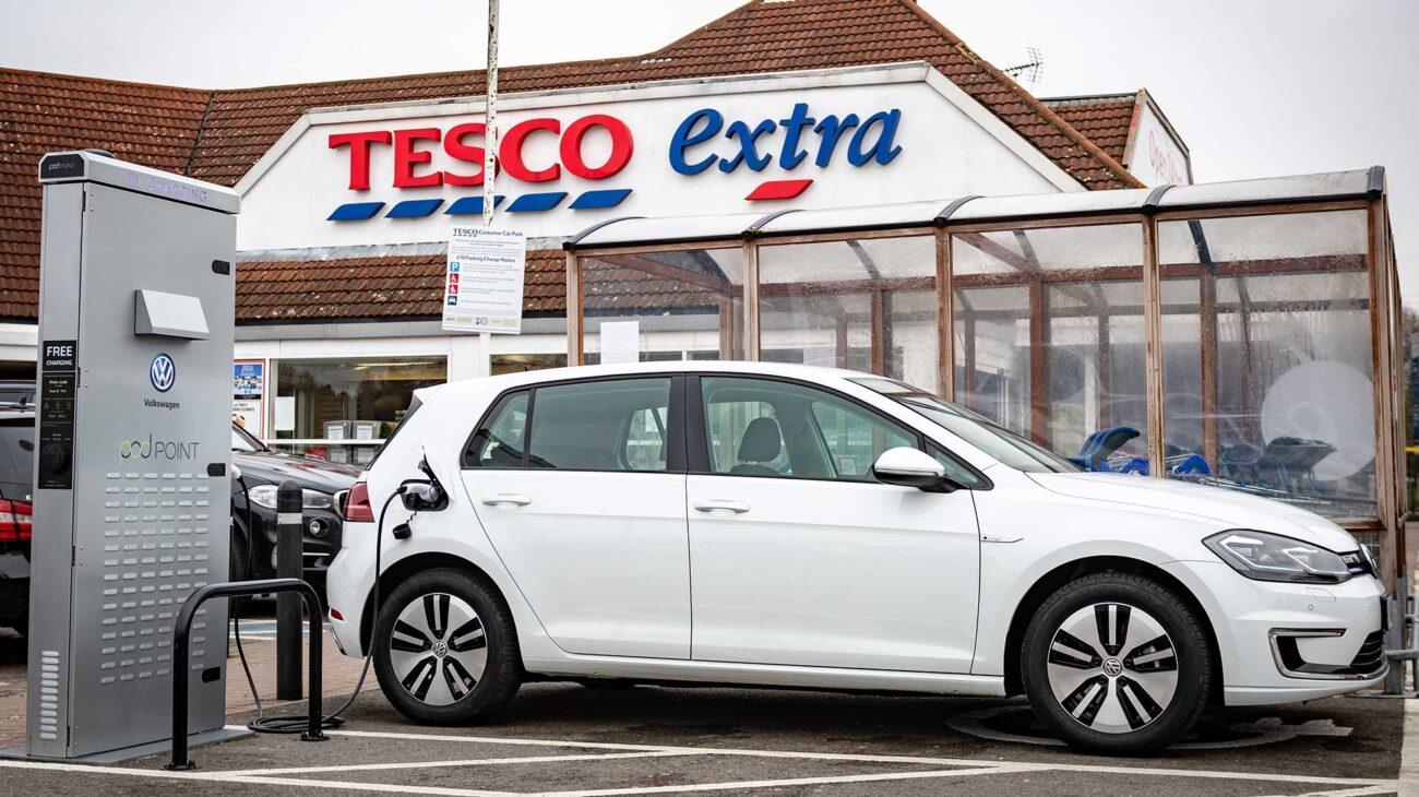 VW EV charging in a Tescos parking spot