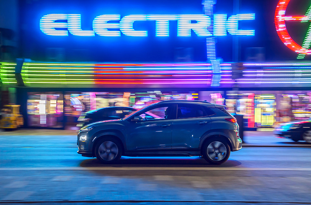 Hyundai Kona Electric driving through a city