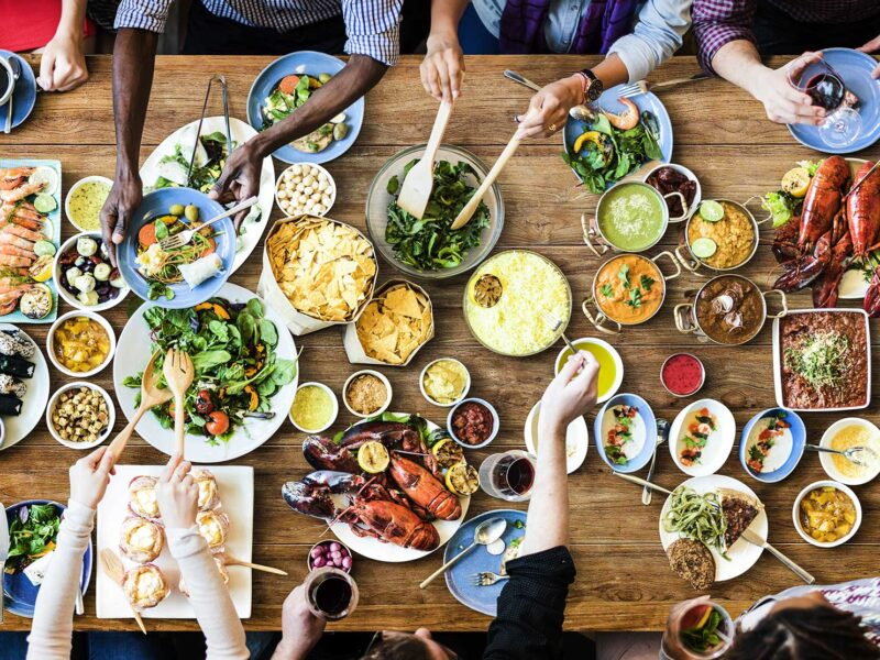 Aerial view of people feasting at a table