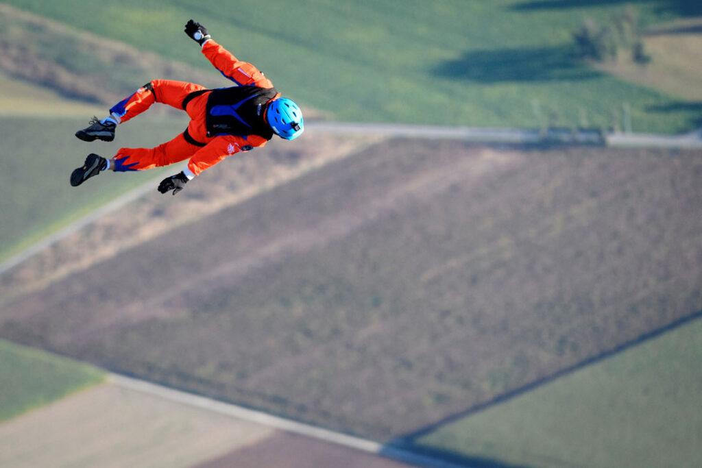 Raphael Domjan free falling above fields in Western Switzerland