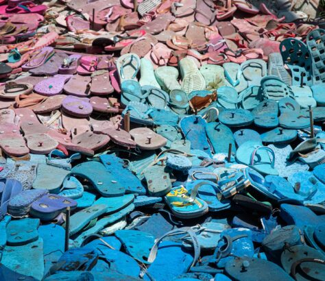 A landfill full of old flip flops