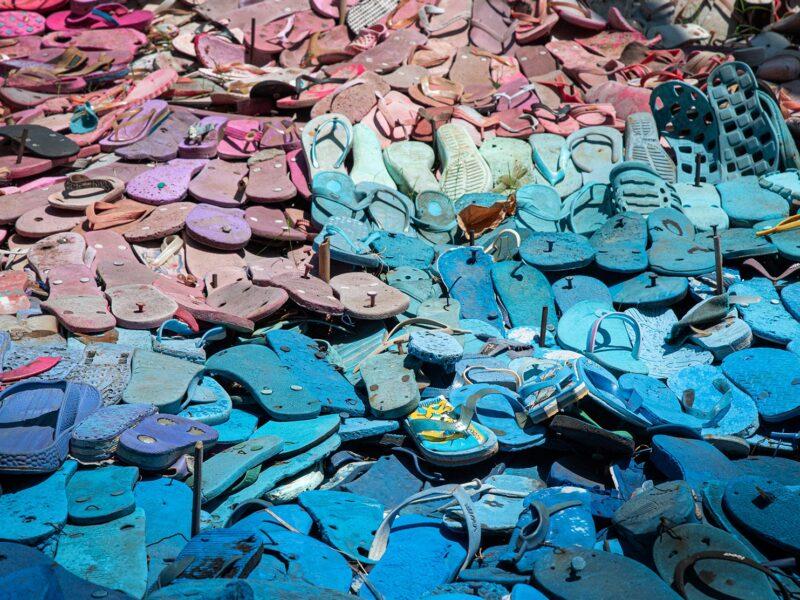 A landfill full of old flip flops