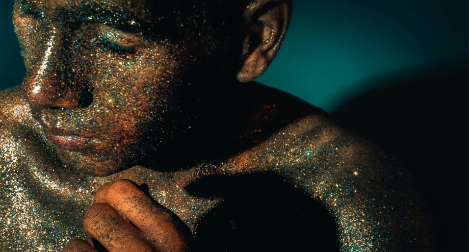 Man covered in glitter