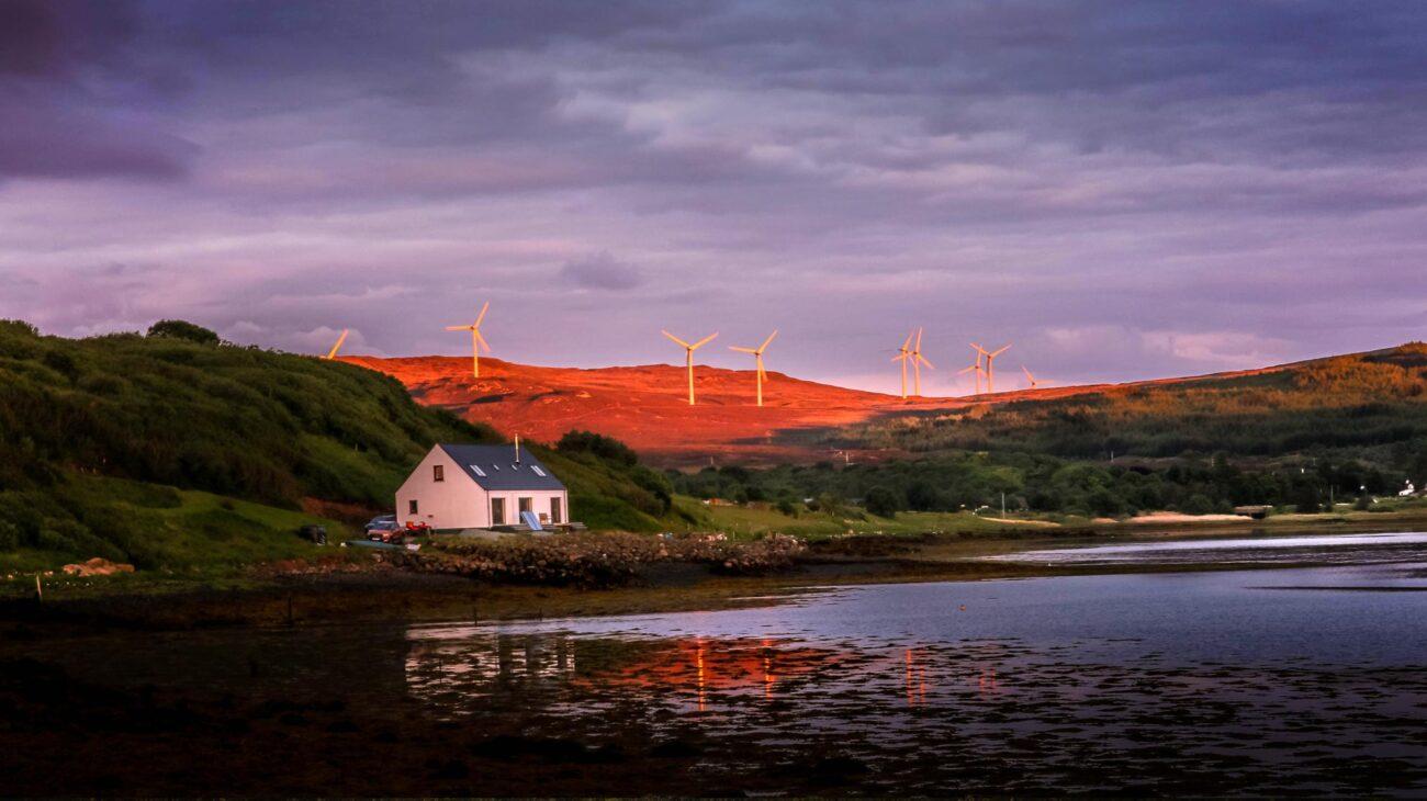late dusk shot over windfarm at loch greshornish on isle of skye scotland