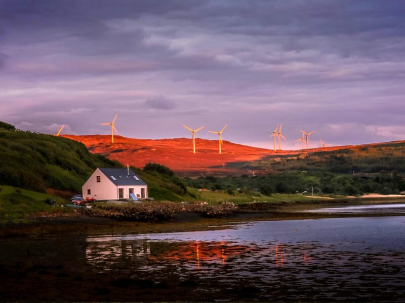 late dusk shot over windfarm at loch greshornish on isle of skye scotland