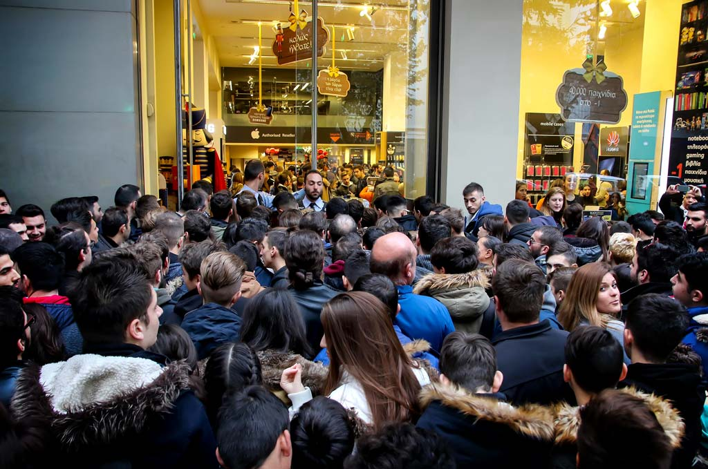 People wait outside a department store during Black Friday shopping deals, at the northern Greek city of Thessaloniki.