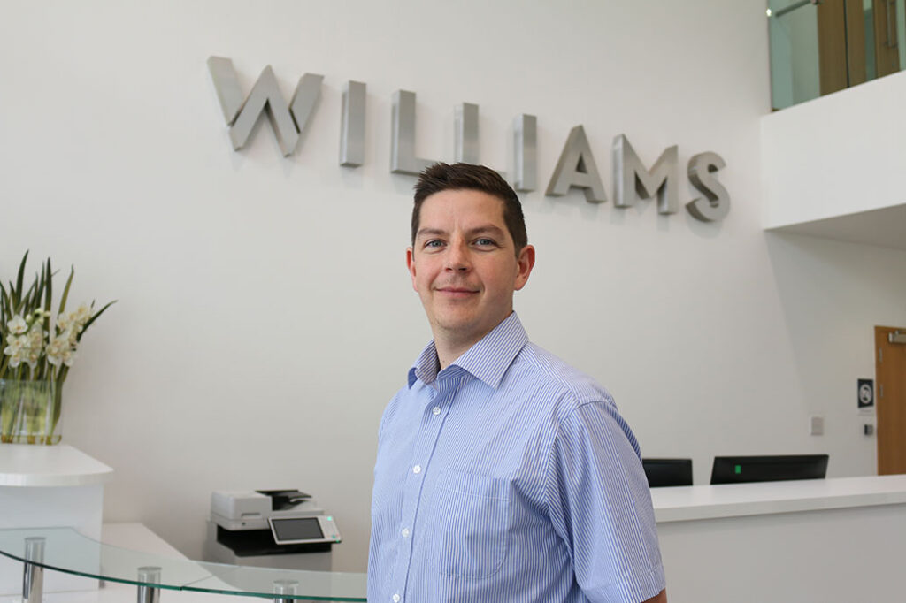 Glen Pascoe stood in the reception at Williams Advanced Engineering
