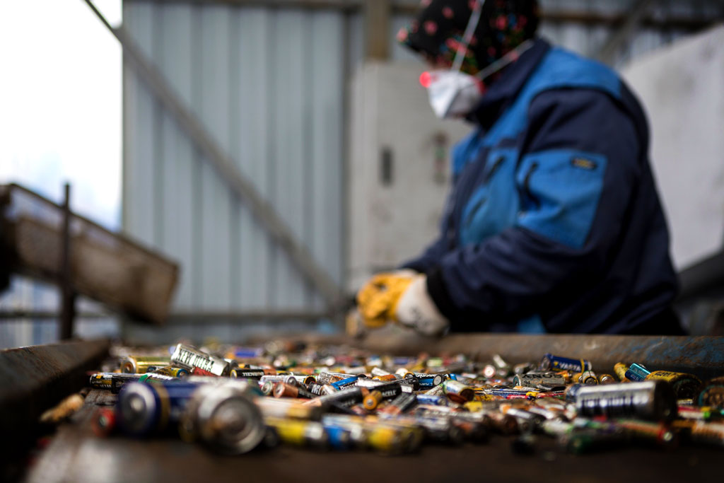 A worker separating used batteries on a conveyor band in a recycling plant, Izimit, Turkey - Photo by Sahan Nuhoglu