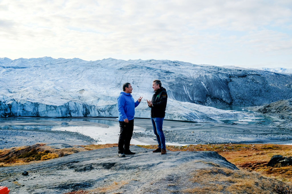Jess-Svane-Greenlands Minister for Industry Energy and Science chats with Extreme-E Founder Alejandro Agag in front of the Russell Glacier