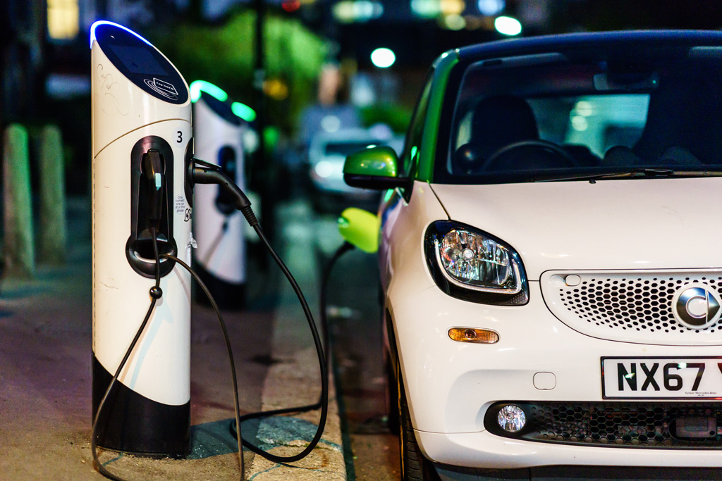 Smart electric car charging in the London Street at night