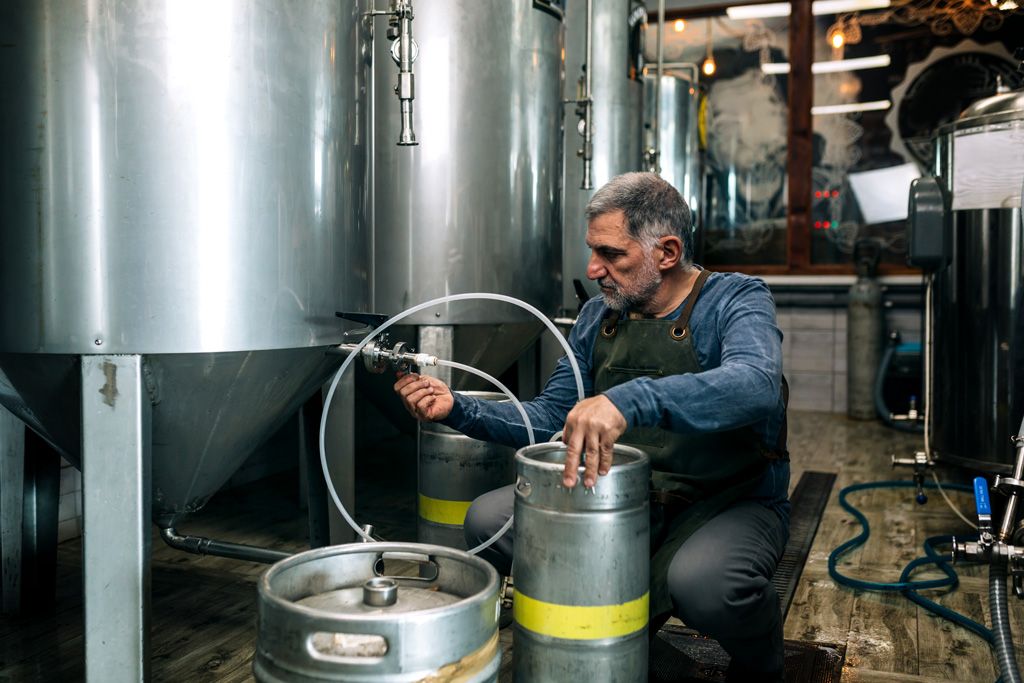brewer working in his craft beer brewery