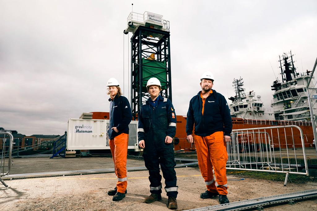 Pavel Trojcinsky,  Engineer, Huisman; Miles Franklin, Lead Engineer, Gravitricity; Bohdan Klims, Engineer, Huisman in front of the Gravitricity Tower, Leith.