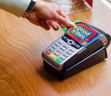 A person swiping an Ekko Mastercard